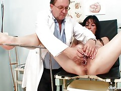 Aged brunette hair babes with nice body and nasty breasts is sitting the gynecologist table absolutely undressed with her legs spread so that her doctor can exam the wet crack between them. He recommends her a dildo therapy so the treatment begins as he introduces that sex toy unfathomable in her shaved vagina. This babe becomes horny and does treats her pussy with her own hands.