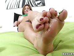 Lisa X is one fine woman from head to toe. Charming Eyes, sweet large tits, lean legs, a nice, round ass, and one yummy-looking pussy! The star this day is her feet, however, and she's getting 'em lubed up to take a ramrod between 'em and make her stud cum! If she's this good with her feet, then....