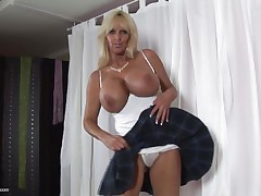 mature whores from usa are known to be sexy and naughty. Here we have Tia Gunn, a blonde whore with giant boobs and a lewd face that can give any guy an erection. She takes out her melons after a short talk and taunts us with 'em by squeezing 'em hard. Do u think this babe deserves a cock between her wobblers and some semen?