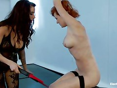 Redhead serf has her hand tied up over her head and enjoys being punished by her hot mistress. Her teats acquire so hard, being pinched by a magic electric wand. As a reward, that babe gets her wet crack fingered and becomes so horny, that babe wants to cum. The goddess prepared more, that babe sticks two dildos in her holes!