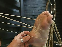 Melody Jordan is all tied up at the moment. She's getting drilled with one leg in the air and enjoying it also much, till a rubber band snap on the foot brings her back to earth. The position switches and now she's bent over with one leg in the air. The guy fingers and fucks her. This babe says thank u sir.