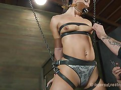 What do we have here? It's a slut, all fastened up in leather belt and hangs there waiting to be punished. She was a very bad girl and her punishment needs to be hard! Wenona has her face hole gagged and the executor rubs her twat with a vibrator. Let's see if this fellow has something to stick it in her gazoo