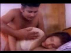 Indian couple having sex on the bed as he kisses her bumpers on livecam